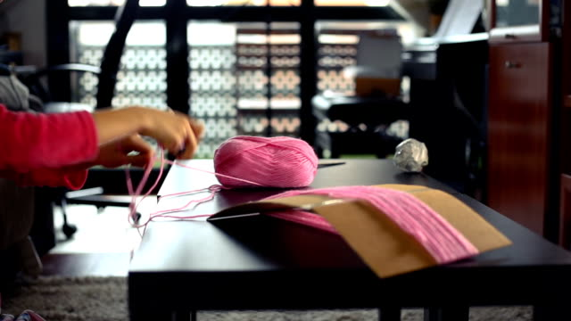 very concentrated girl working on her crafts - ball of wool stock videos & royalty-free footage