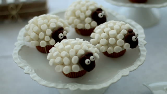 very cute unique chocolate cupcake with sheep animal - cupcake stock videos & royalty-free footage