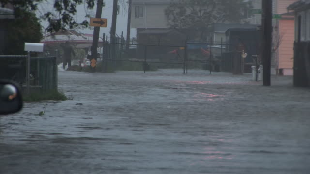 very deep storm surge surrounds homes on a residential street in broad channel, ny as hurricane irene makes landfall in the new york city area. - hurricane irene stock videos & royalty-free footage