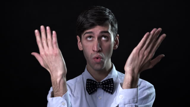a very expressive man in a bow tie - shirt stock videos and b-roll footage
