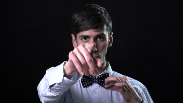 A very expressive man in a bow tie