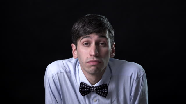 a very expressive man in a bow tie - raised eyebrows stock videos and b-roll footage