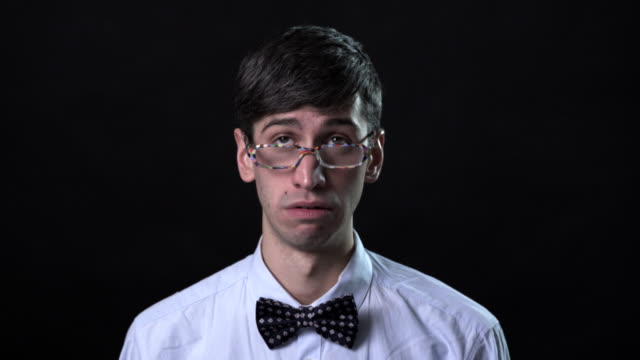 a very expressive man in a bow tie - geek stock videos and b-roll footage