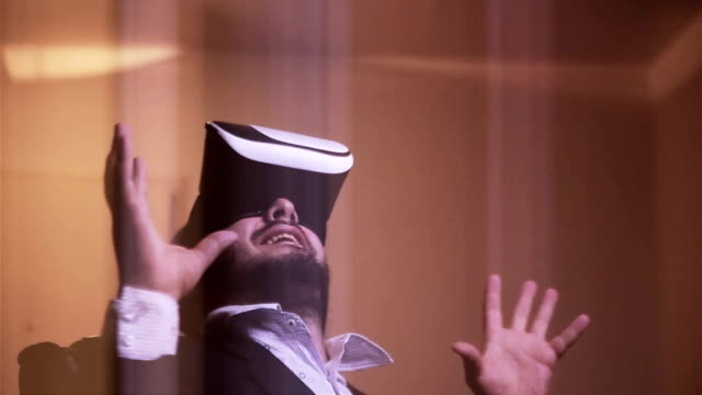 A very funny businessman enjoys in virtual glasses