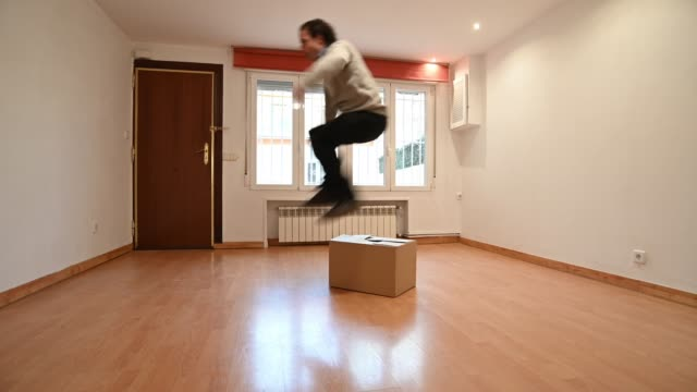 very happy man, celebrating something in a moving environment dances and santa on top of a cardboard box - tenant stock videos & royalty-free footage