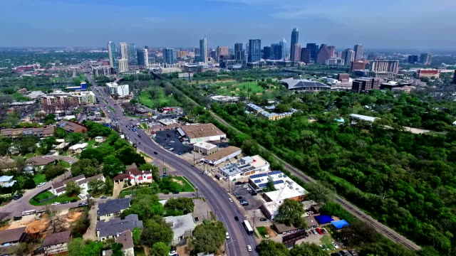 very high aerial drone fly over austin texas 2016 greenbelt springtime gorgeous capital city view from south lamar blvd with skyline cityscape background - south america stock videos & royalty-free footage