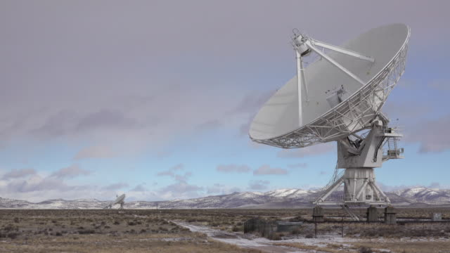 Very Large Array dish radio antenna snowy mountains New Mexico