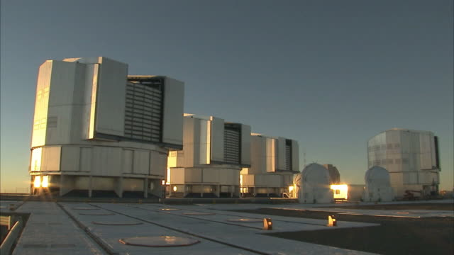 Very Large Telescope (VLT) domes opening in preparation for a night of observations.