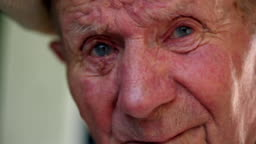 Very old man portrait with emotions. Grandfather sad and depressed. Portrait: aged, elderly, loneliness, senior. Close-up of eyes pensive old man sitting alone outdoors. Slow motion