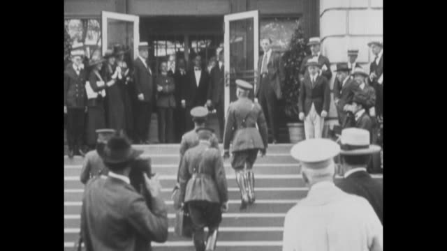 arriving at shoreham hotel / two shots of gen john pershing commander of american expeditionary force and other officers climbing steps to entrance... - john pershing stock videos & royalty-free footage