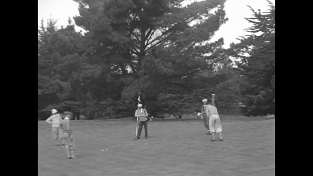 """""""san francisco, calif. - gene tunney, heavyweight champion, is ardent golfer and during recent visit spare moments found him on olympic club links"""" /... - golf links stock videos & royalty-free footage"""