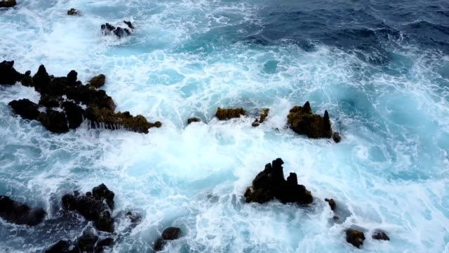 Very Rough Water Crashing onto Rocky Beach on Maui