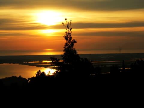 非常にゆっくりと沈む夕日 - 撮影機材点の映像素材/bロール