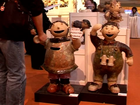 very special artists are giving the hong kong art world a run for its money. at an auction in a luxury shopping mall in the city, clay dolls made by... - male likeness stock videos & royalty-free footage