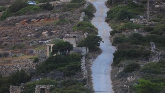 stockvideo's en b-roll-footage met a very steep road allows access to the top of the mountain on august 14 2020 in kostos greece the island of paros has seen increasing tourist numbers... - charmant
