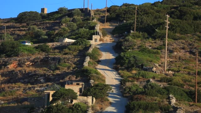 very steep road allows access to the top of the mountain on august 19, 2020 in kostos, greece. the island of paros has seen increasing tourist... - steep stock videos & royalty-free footage