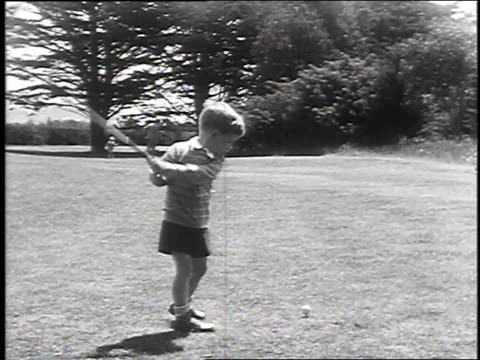 1930 montage very young boy playing golf, june 8, 1930 / san fransisco, california  - golf stock-videos und b-roll-filmmaterial
