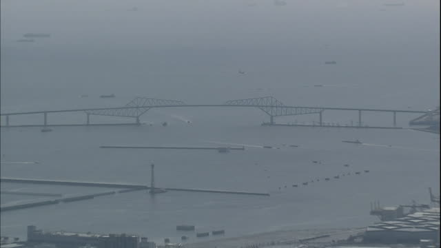 vessels sail beneath the tokyo gate bridge. - ariake sea stock videos and b-roll footage