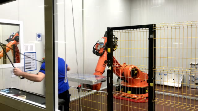 A Vestel City employee works on with a robot building a television in the Vestel City mega factory on May 14 2018 in Manisa Turkey The Vestel City...
