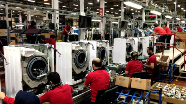 Vestel City employees work on a washing machine production line in the Vestel City mega factory on May 14 2018 in Manisa Turkey The Vestel City mega...