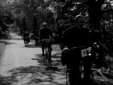 ripley m veterans along cs woman in old—fashioned dress past ms more past ms penny farthing — man tries to get on ci1s woman rides past ms... - pedal stock videos & royalty-free footage