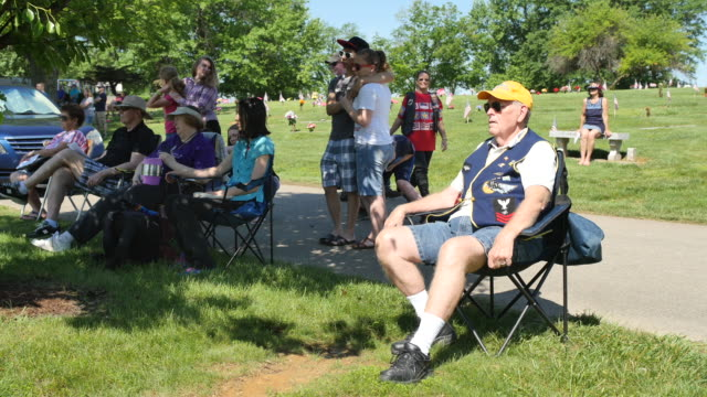 veterans and others listen to a speaker during memorial day ceremonies at valhalla memory gardens may 29 2017 in bloomington ind a new war memorial... - veterans of foreign wars of the united states stock videos & royalty-free footage