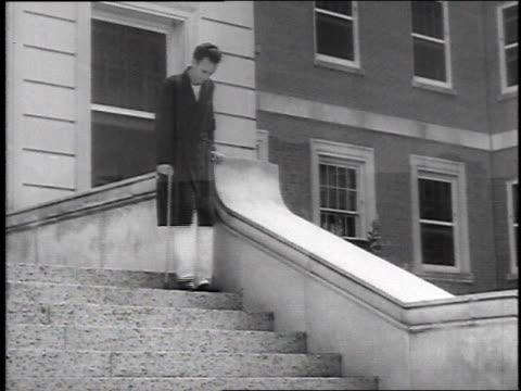 ls veteran's hospital / veteran walking down hospital stairs with cane - bathrobe stock videos & royalty-free footage