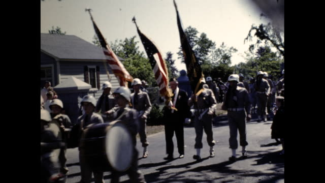 a veterans of foreign wars banner that commemorates westboro citizens that were killed in ww2 military with instruments marching in a parade in... - veterans of foreign wars of the united states stock videos & royalty-free footage