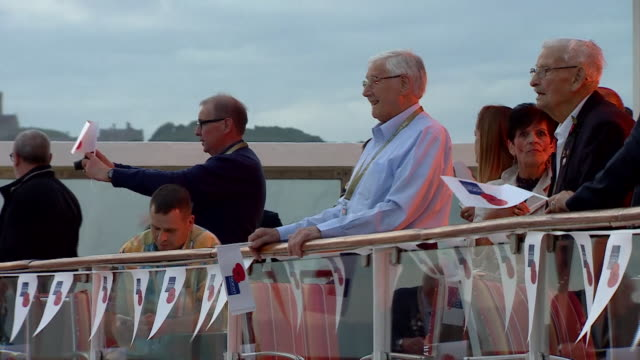 wwii veterans on a ship to normandy for dday commemorations - d day stock-videos und b-roll-filmmaterial