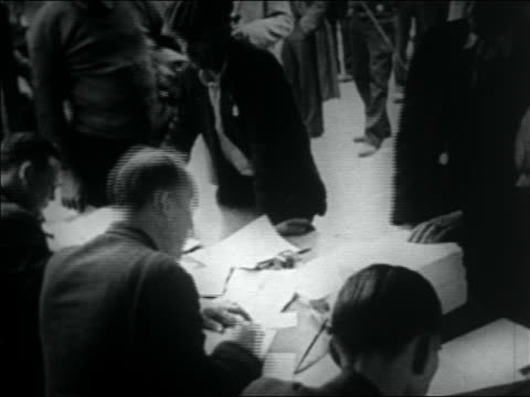 wwi veterans registering with men at tables for bonus march / washington dc - 1932 stock videos & royalty-free footage