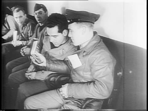 veterans sitting on a bench outside a office in a new jersey war plant, man in suit brings one into his office / uniformed men in that line, one man... - 1943 stock-videos und b-roll-filmmaterial