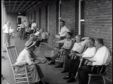 stockvideo's en b-roll-footage met ws veterans sitting on a porch / usa - schommelen schommelstoel