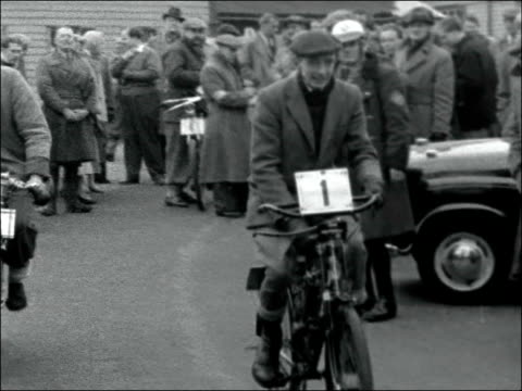veterans take part in race from epsom to brighton england surrey tattenham corner ext various shots of motorcycles at start exact location unknown... - motorcycle biker stock videos and b-roll footage