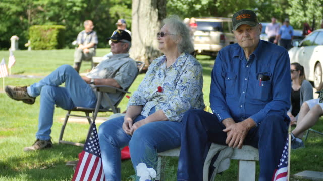 veterans their families and others listen to a speaker during memorial day ceremonies at valhalla memory gardens may 29 2017 in bloomington ind a new... - veterans of foreign wars of the united states stock videos & royalty-free footage
