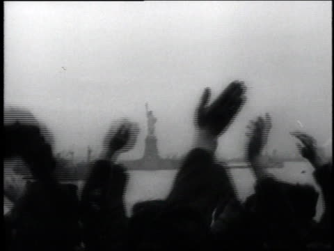 veterans wave from ship as they approach new york harbor / new york city, new york, united states - freiheitsstatue stock-videos und b-roll-filmmaterial