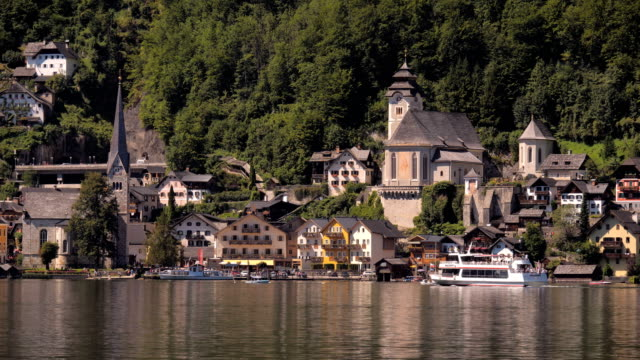 Vew of Hallstatt from across the Lake with tourist boats
