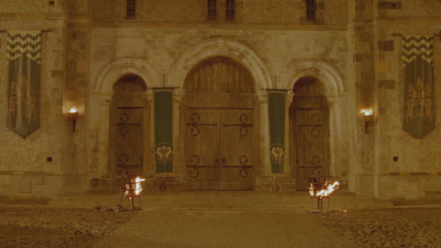 vfx plate night interior castle courtyard w/fire light - courtyard stock videos & royalty-free footage