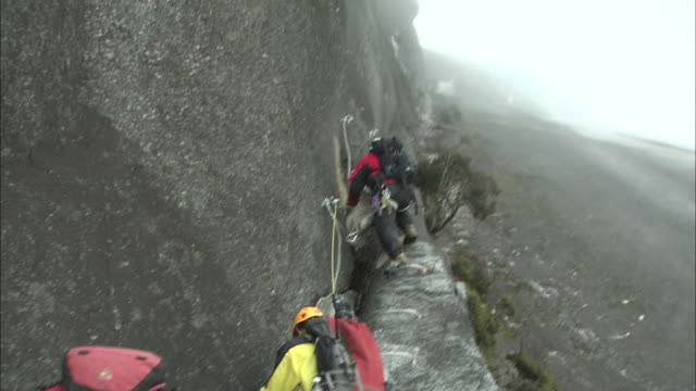 via ferrata  in malaysia   - rock face stock videos & royalty-free footage