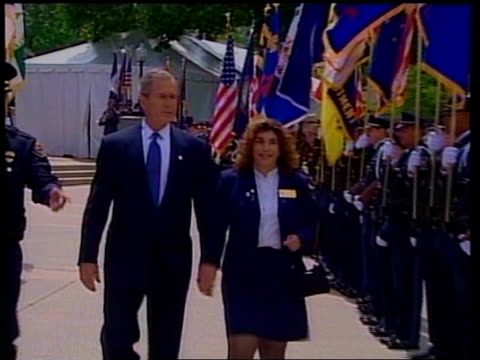 pool via reuters ms bush towards with woman past soldiers holding flags pull - reuters stock videos & royalty-free footage