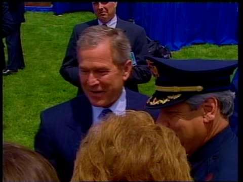 pool via reuters tms bush speaking to woman as standing next police officer fade to - reuters stock videos & royalty-free footage