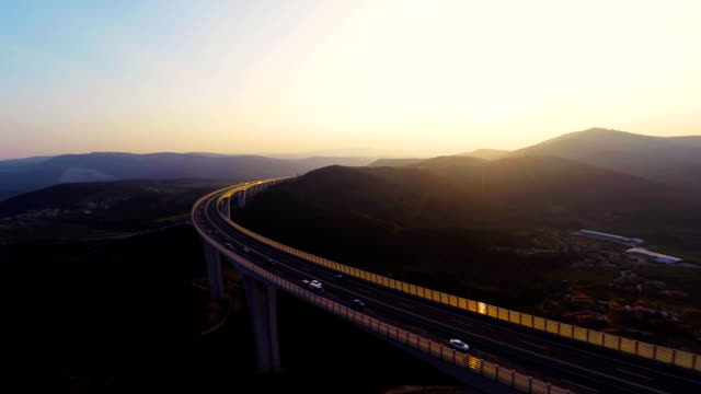 hd heli: viaduct at dusk - car on road stock videos & royalty-free footage