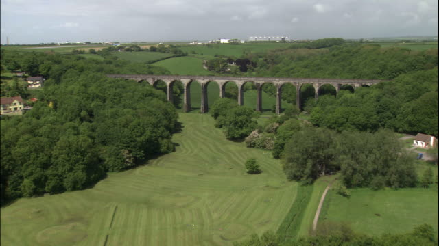 viaduct ruins cross over a lush green countryside in barry, wales. - wales stock videos & royalty-free footage