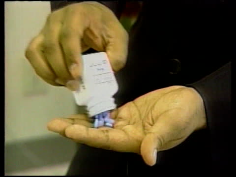 viagra prescriptions restricted lib tablets poured into hand - anti impotence tablet stock videos & royalty-free footage