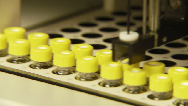 CU PAN R/F Vials of water samples in laboratory machine / Riverside, California, USA