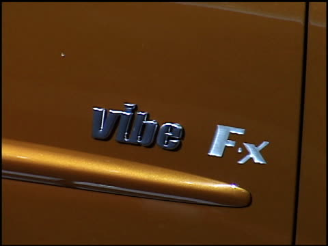 cu vibe fx info sign / cu vibe fx fender emblem zo to ms passenger side profile of front end / ws front end of car 2002 pontiac vibe fx concept car... - pontiac stock videos and b-roll footage