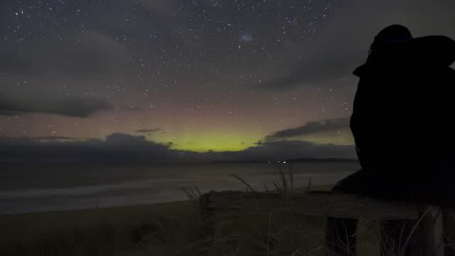 vibrant and active display of the aurora australis or southern lights, tasmania - aurora australis stock videos & royalty-free footage