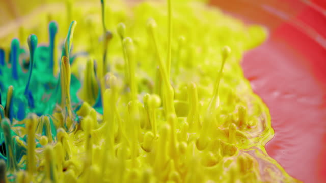 slo mo vibrant colors dance to vibration - yellow stock videos & royalty-free footage