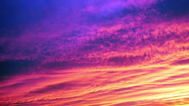 vibrant colors on rain clouds. from sunset to night. - serenità video stock e b–roll