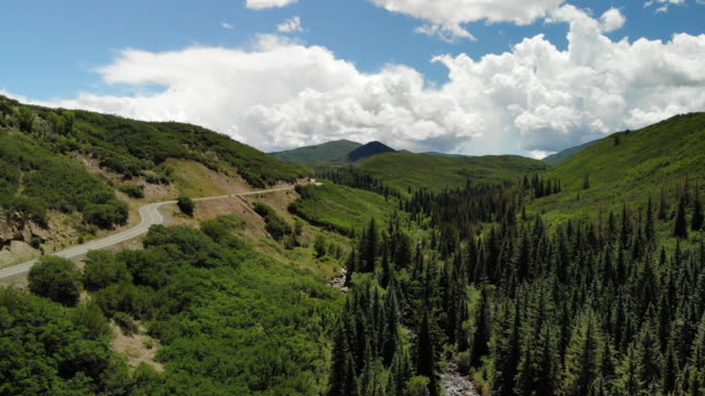 vibrant majestic mountains and cloudscapes grand mesa national forest road to vega dam and reservoir with view of plateau creek 4k video - majestic stock videos & royalty-free footage