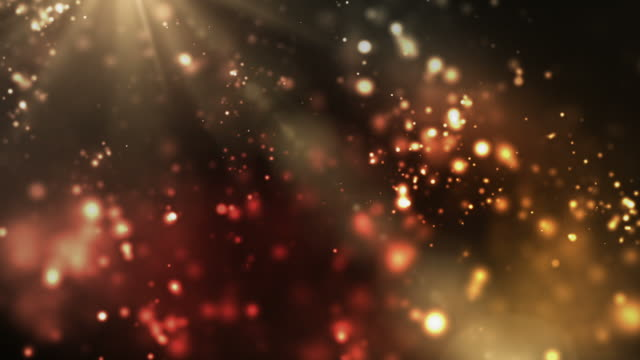 vibrant night sparkles loop - orange/red (full hd) - glitter stock videos & royalty-free footage